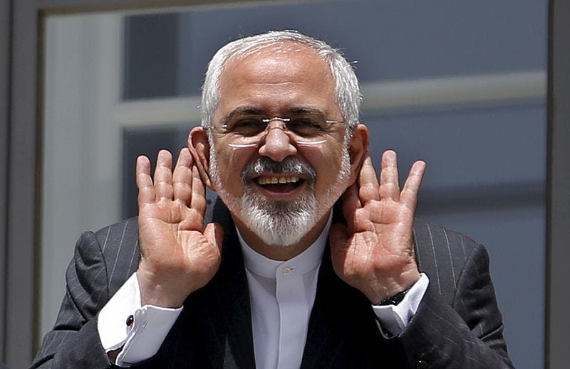 Iranian Foreign Minister Mohammad Javad Zarif gestures as he talks with journalist from a balcony of the Palais Coburg hotel where the Iran nuclear talks meetings are being held in Vienna, Austria July 10, 2015. REUTERS/Carlos Barria