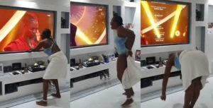 Drama As Excited Fan Removes Her Towel, Bows Before Laycon As He Wins #BBNaija 2020 (Video)