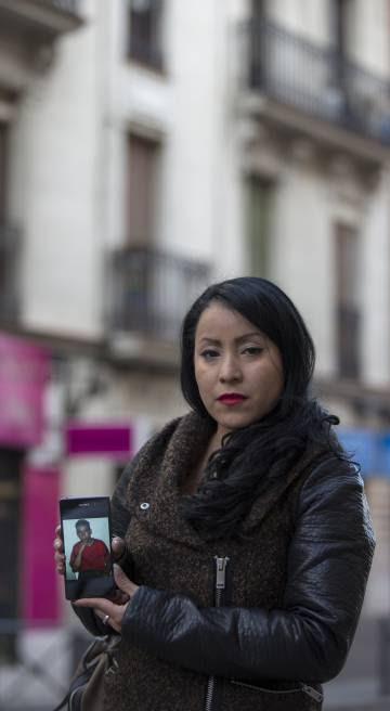 Carmen Estacio with a photograph of her brother, Diego Armando.
