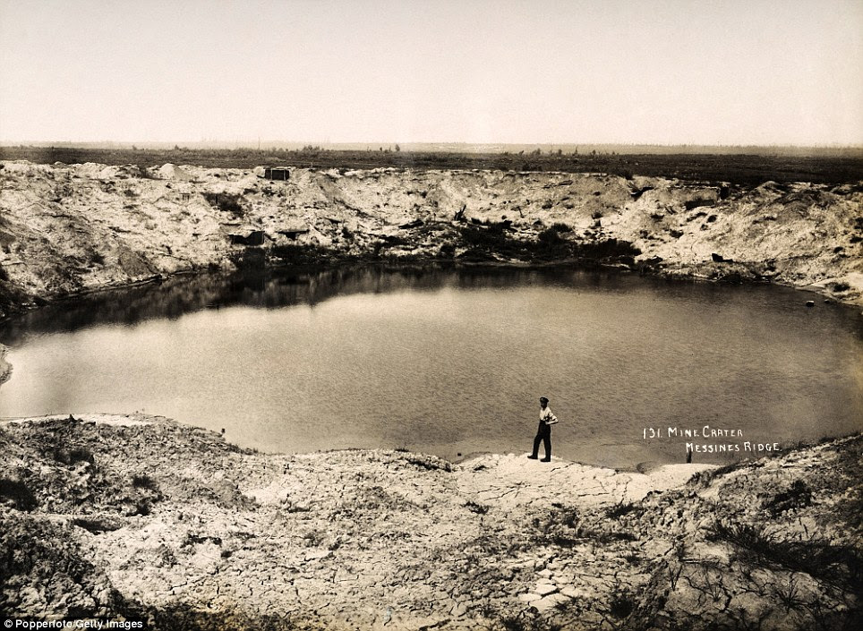 Shaping nature: A huge bomb crater at Messines Ridge in Northern France, photographed circa March 1919, soon after the end of World War One