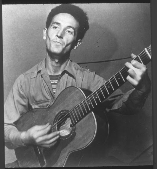 Pop culture applies Woody Guthrie's political barbs masked in all-American balladry