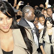 Pregnant Kim Kardashian is mobbed by fans as she arrives on the Ivory Coast... just hours before bogus shooting panic