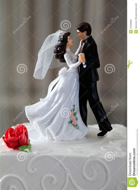 Wedding cake and topper stock photo. Image of male, couple