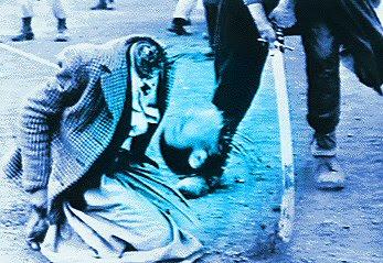 http://keeptonyblairforpm.files.wordpress.com/2008/12/sharia_law_beheading.jpg