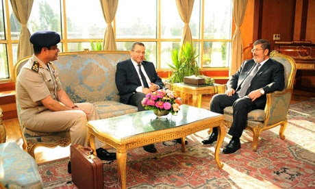 The Egyptian Presidency has released this photograph of Mohamed Morsi, and his prime minister Hesham Qandil meeting the head of the army Abdel-Fattah el-Sisi, left in Cairo.
