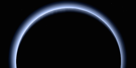 This blue-sky image of Pluto is absolutely stunning