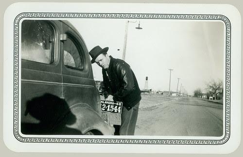 Man at rear of car
