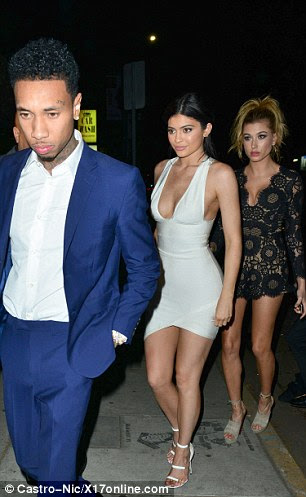 Also there was a glum-looking Tyga, 26, who had on a royal blue suit and white shirt