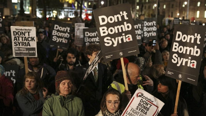 Anti-war protesters demonstrate against proposals to bomb Syria outside the Houses of Parliament in London [REUTERS]