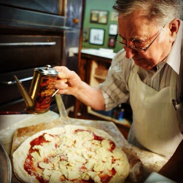 Difara's pizza in midwood section of Brooklyn. This man does not cut corners when it comes to fresh ingredients.