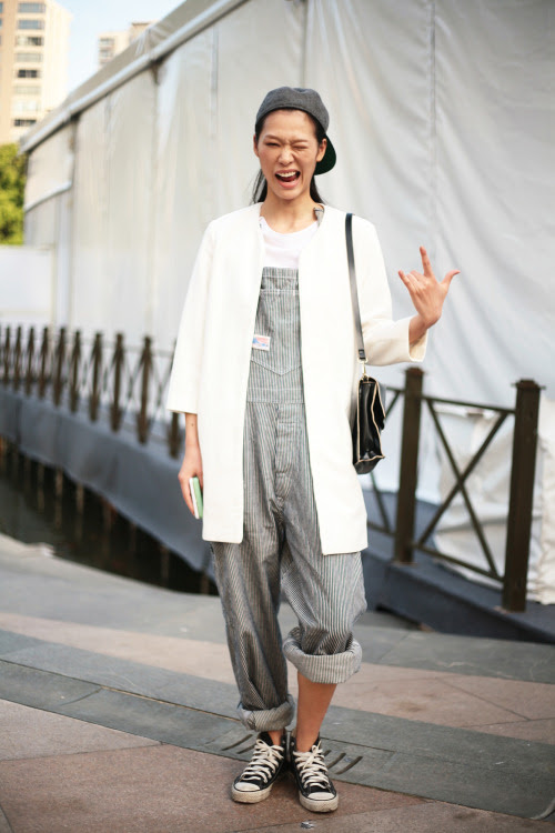 Rocking it in dungarees at Shanghai Fashion Week 2014. WGSN street shot #shanghaifashionweek #streetstyle