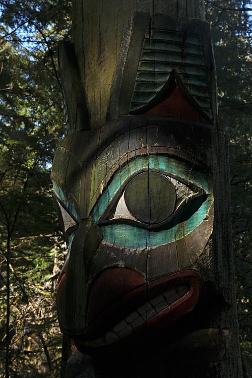 bear memorial totem in shadow, Totems Historic District, Kasaan, Alaska
