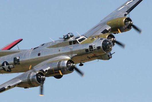USAF Museum's Memphis Belle Unveiling Festivities Begin With B-17, P-51 Flyover [Video]