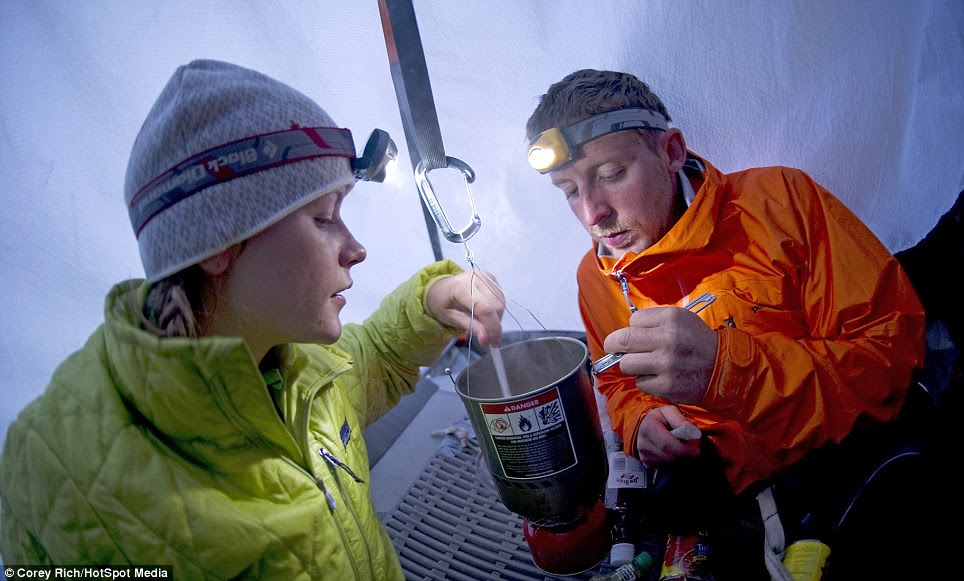 Cooking dinner while hanging off a cliff is a strange thought, but for the couple it was the only way to eat