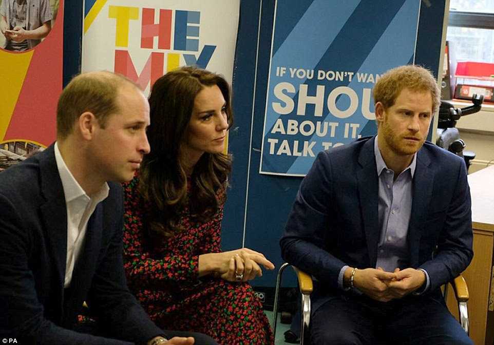 The royal trio listen intently as they learn more about the work of the charity The Mix, which supports the under 25s through issues such as homelessness and addiction