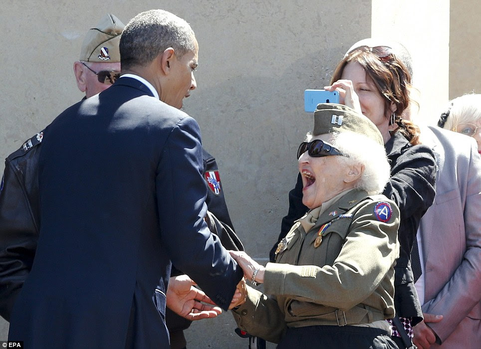 Excited: A female decorated war veteran appeared thrilled to meet President Obama face to face at the Normandy American Cemetery and Memorial in Colleville-sur-Mer