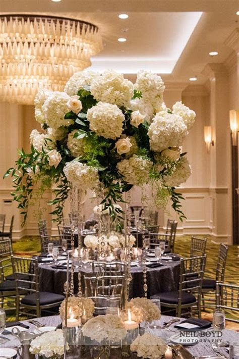 Tall white floral centerpieces. Raleigh, NC weddings