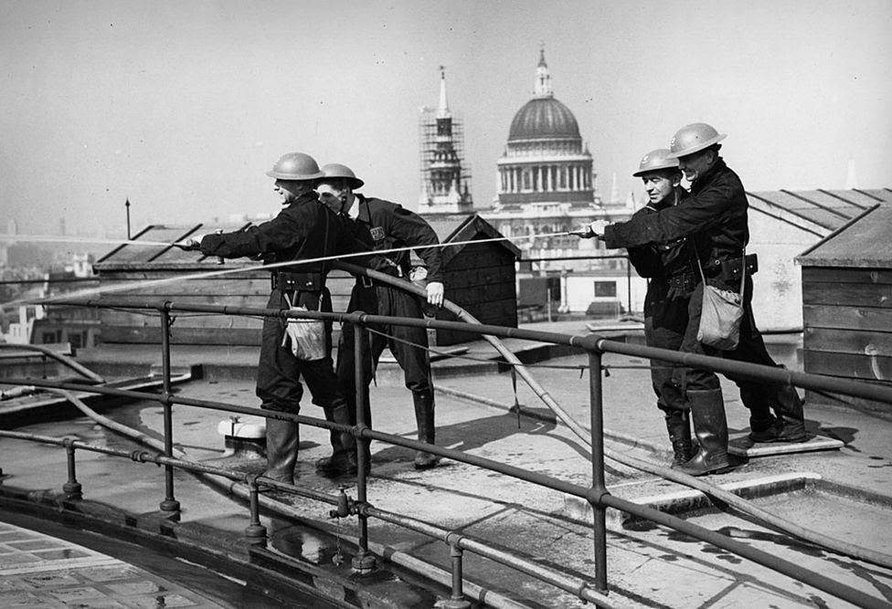 Auxiliary Fire Brigade hose drill on the roof of the Bank of England, WW2