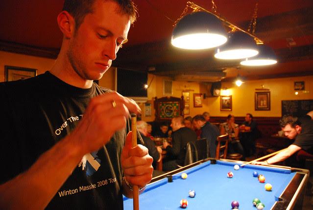 Ben playing pool.