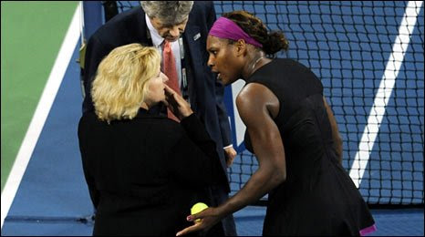Serena Williams (right) talks to US Open referee Brian Earley and Grand Slam supervisor Donna Kelso