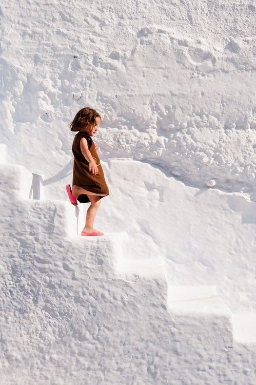 Love this photo of a child exploring the Greek Islands!