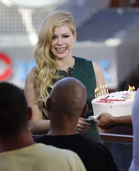 Avril Lavigne receives a birthday cake while doing an interview for the show EXTRA in Universal City, California on September 24, 2013. Avril turns 29 on September 27th.