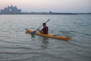 Steen in a kayak in front of Atlantis