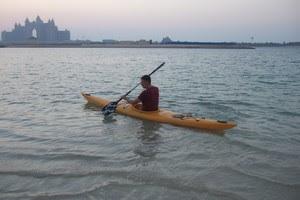 Steen in a kayak in front of Atlantis
