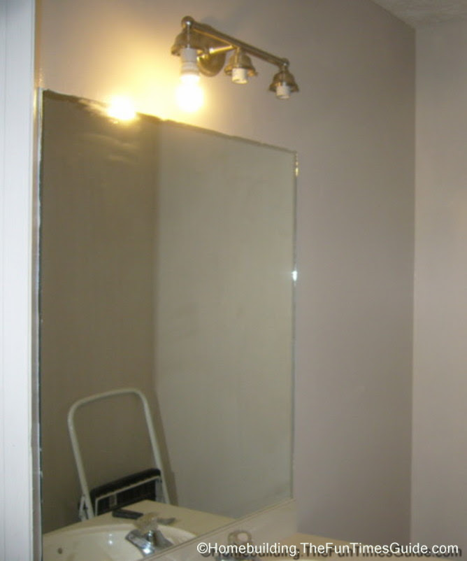 How To Build A Custom Frame For A Bathroom Mirror - The Fun Times ...