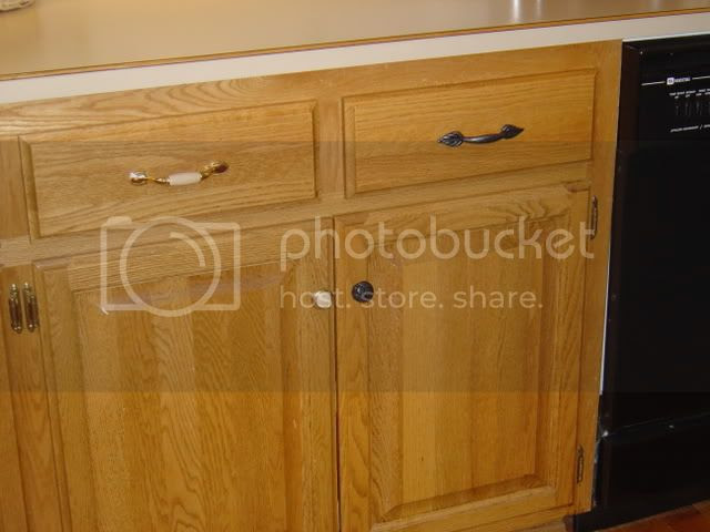 What type of finish on knobs, handles, & lights in oak ...