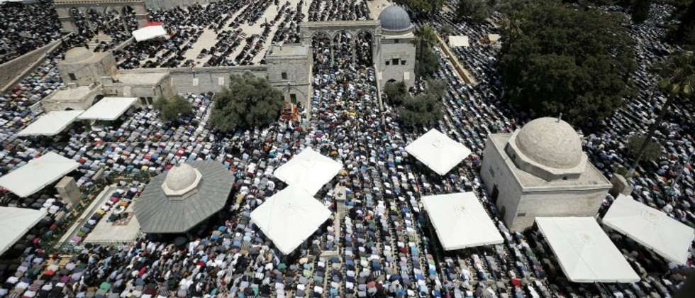 Muslim worshipers pictured in June praying near the Dome of the Rock mosque in the Al-Aqsa Mosque compound in Jerusalem, the site of recent clashes between Israeli security forces and Palestinians ( Ahmad Gharabli (AFP/File) )