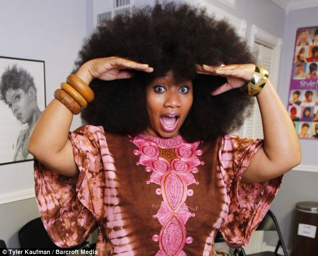 Aevin getting her hair tended to at a salon in Reserve, Louisiana. Her mother says that she is particularly proud of her daughter for wearing her afro before it became fashionable