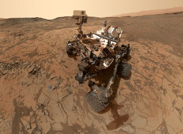 A cropped version of the Curiosity Mars rover's self-portrait, taken with a camera on her robotic arm in late January of 2015.