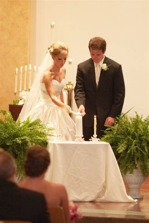 Catholic wedding. Bride and groom using their baptism