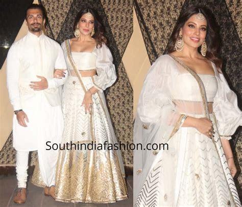 Bipasha Basu in a white lehenga at Sakshi Bhatt's wedding