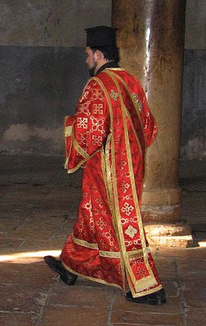 Greek Orthodox deacon in the Church of the Nat...