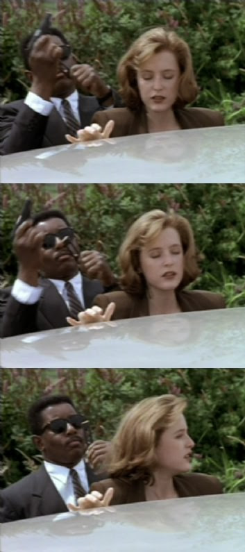 FBI Agent Dana Scully meets a man in black who looks with sunglassed wonder at her empty magazine as she realizes how embarrassing 'loading it all the way hurts my thumb' sounds from a FBI agent