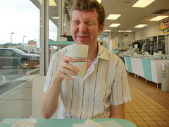 Pete taking his first sip of Krispy Kreme coffee (for this trip)