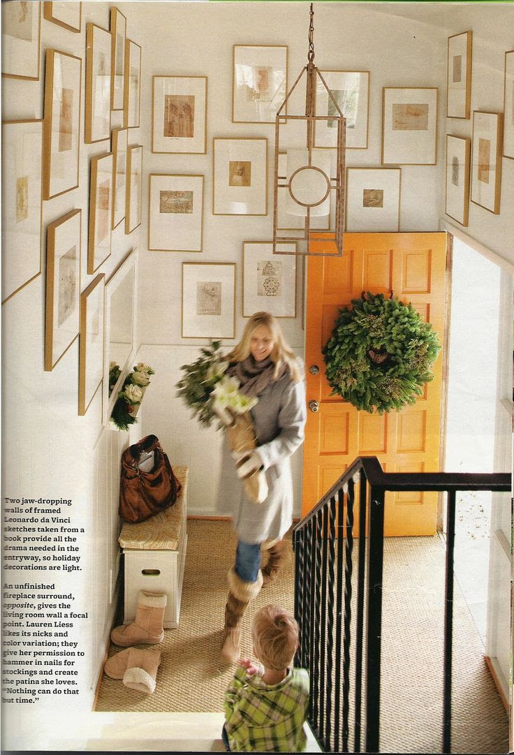this is one of my favorite foyers ever. And the orange door?  Love!