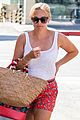 reese witherspoon pairs her white tank with a skirt shorts 02
