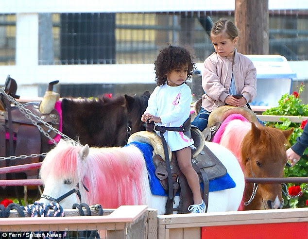 Taking a ride: The two looked slightly hesitant as they rode their ponies together