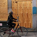 A cyclist in New York this week rode by a business that has been closed since Hurricane Sandy hit. The storm has contributed to the weakening of the economy.
