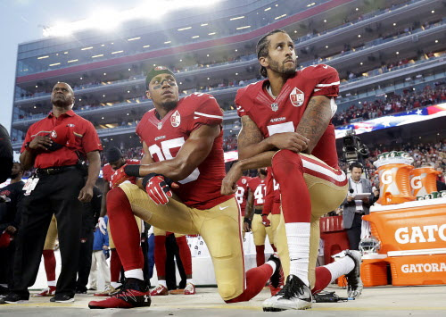 Report: Kaepernick ends protest, will stand during national anthem next season
