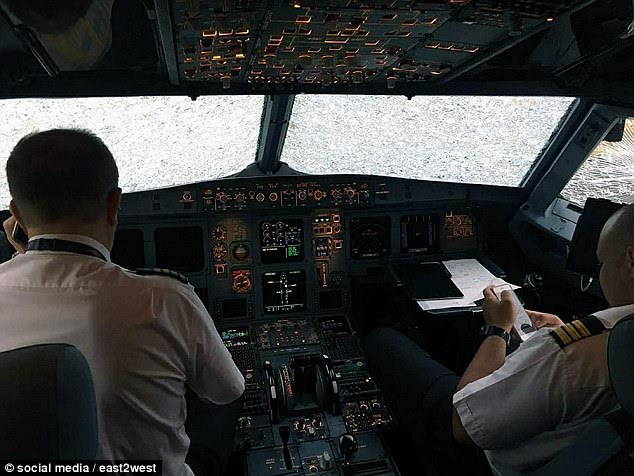 Born again: Capt Akopov said he and other crew were celebrating as if it was a 'second birthday' after his life-saving heroics in coping with damage caused by hailstones the size of hen's eggs which left a gaping gash in the plane and disabled his auto pilot