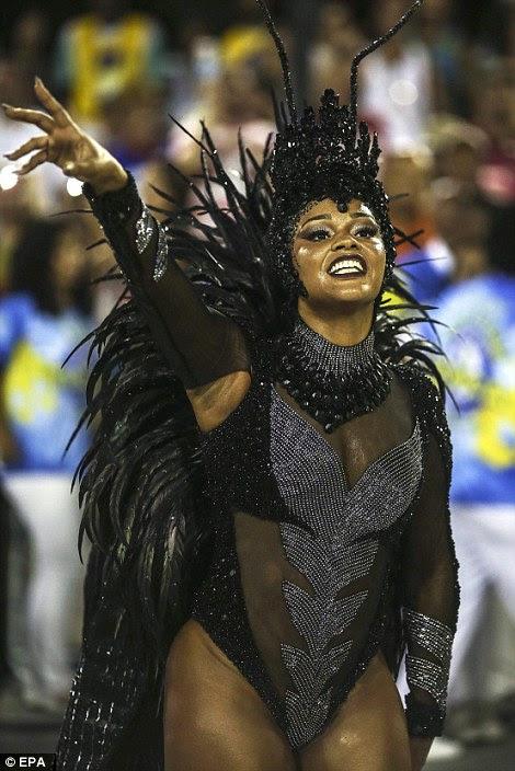 A member of the Samba school Unidos da Tijuca takes part in the parade
