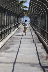 Pedestrian overpass with runner