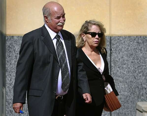 "Mary Nolan leaves the federal courthouse with attorney Richard Guadgani in Oakland, Calif. on Tuesday, Sept. 25, 2012 after pleading not guilty to six charges of wire-tapping and tax invasion. Nolan, a San Ramon divorce attorney, has been linked to the ""dirty DUI"" scandal involving former private investigator Christopher Butler. Photo: Paul Chinn, The Chronicle"
