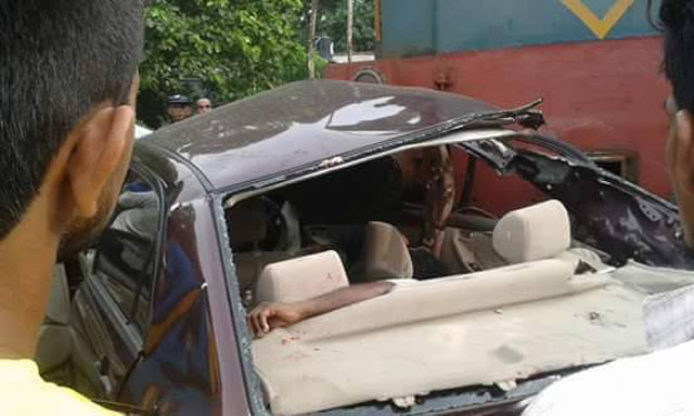 Car collides with train killing three, injuring one