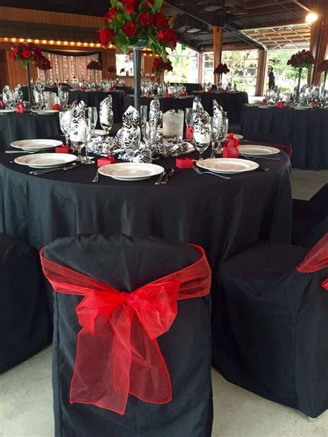Black table cloth, damask satin overlay bunched in middle