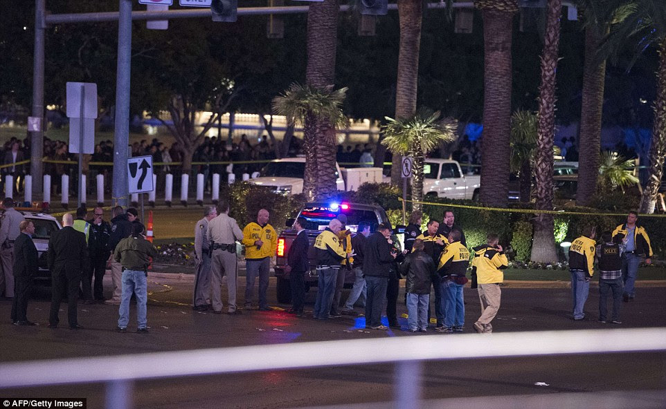 Police and local officials investigate part of the Las Vegas Strip after a car ran into a group of pedestrians between Planet Hollywood, where the Miss Universe pageant took place, and the Paris Las Vegas Hotel in Las Vegas